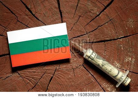Bulgarian Flag On A Stump With Syringe Injecting Money In Flag