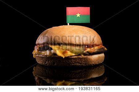 Burkina Faso Flag On Top Of Hamburger Isolated On Black Background
