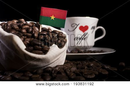 Burkina Faso Flag In A Bag With Coffee Beans Isolated On Black Background