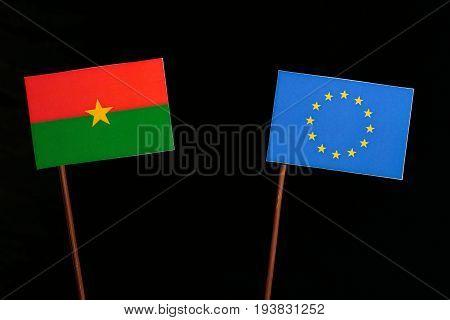 Burkina Faso Flag With European Union (eu) Flag Isolated On Black Background