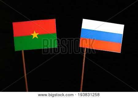 Burkina Faso Flag With Russian Flag Isolated On Black Background