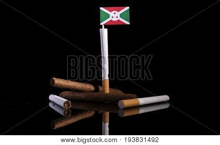 Burundi Flag With Cigarettes And Cigars. Tobacco Industry Concept.
