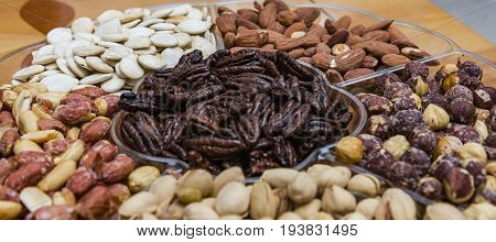 Background from various kinds of nuts almond hazelnut cashew Brazil nut Nuts are different