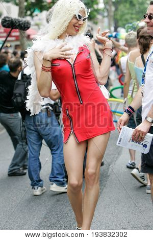 Paris France - Jun 27 2015: Transsexual with a red dress during the annual Gay Pride Parade in Paris France.