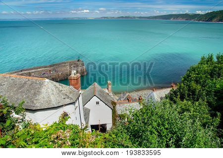 Scenic View of the cozy English village of Clovelly. Below you can see the pier. Calm sea on a sunny day. Devon. England