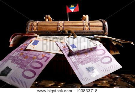 Antigua And Barbuda Flag On Top Of Crate Full Of Money
