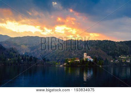 Magical sunset landscape with the island on Lake Bled (Blejsko jezero). Julian Alps Slovenia