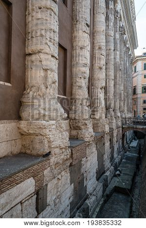 Rome Italy - August 18 2016: Detail of columns in Adrian Temple in Piazza di Pietra in Rome a sunny summer day