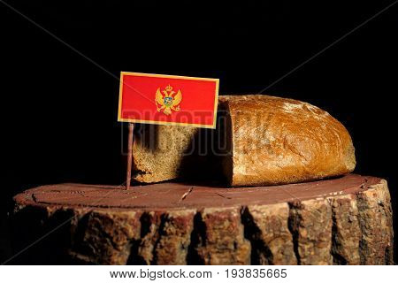 Montenegrin Flag On A Stump With Bread Isolated