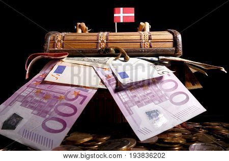 Danish Flag On Top Of Crate Full Of Money
