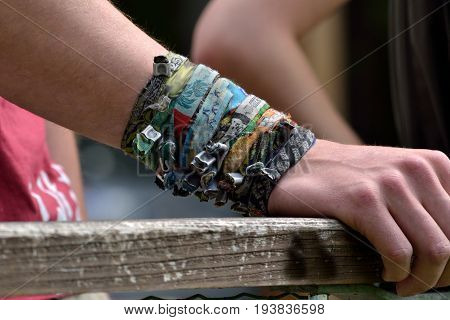 A collection of bracelets on one arm