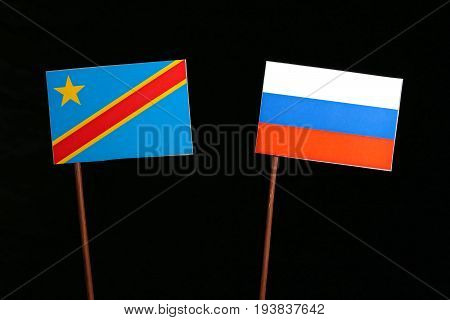 Democratic Republic Of The Congo Flag With Russian Flag Isolated On Black Background