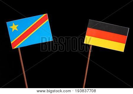 Democratic Republic Of The Congo Flag With German Flag Isolated On Black Background