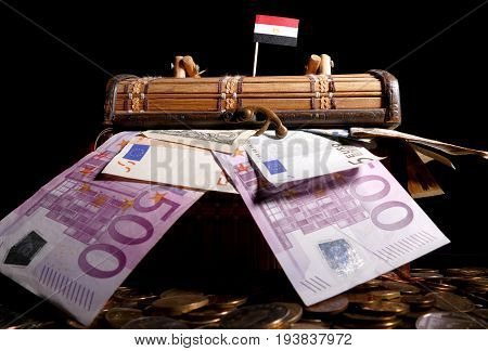 Egyptian Flag On Top Of Crate Full Of Money