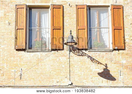 Ferrara, Italy - June, 30, 2017: sun blinds on a windows of an inhabited house in Ferrara, Italy