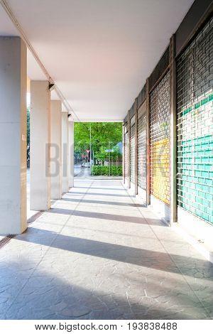 Ferrara, Italy - June, 30, 2017: modern colonnade in a house in Ferrara, Italy