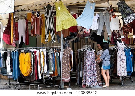 Ferrara, Italy - June, 30, 2017: clothes sold in a street market in Ferara, Italy