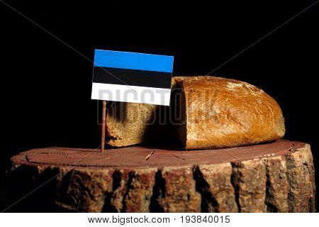 Estonian Flag On A Stump With Bread Isolated