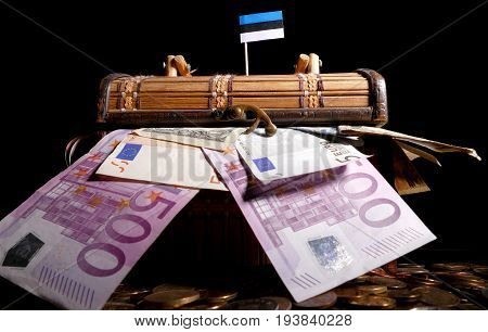 Estonian Flag On Top Of Crate Full Of Money