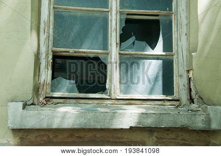 Part of broken window. Close up of broken glass window.