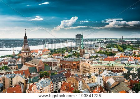 Riga, Latvia. Riga Cityscape In Sunny Summer Day. Famous Landmarks - Riga Dome Cathedral And St. James's Cathedral, or the Cathedral Basilica of St. James