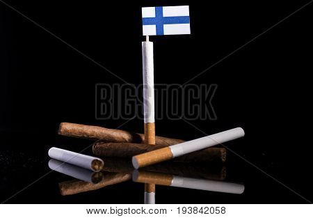 Finnish Flag With Cigarettes And Cigars. Tobacco Industry Concept.