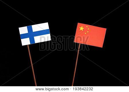 Finnish Flag With Chinese Flag Isolated On Black Background