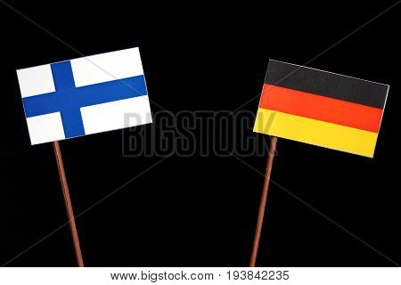 Finnish Flag With German Flag Isolated On Black Background
