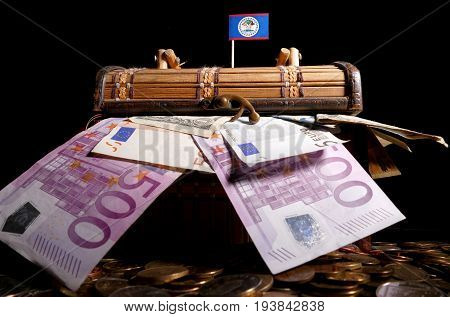 Belize Flag On Top Of Crate Full Of Money