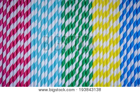 red, blue, green , yellow straw, background