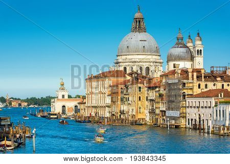 Grand Canal with Basilica di Santa Maria della Salute in Venice, Italy. Grand Canal is one of the major water-traffic corridors in Venice.