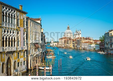 Grand Canal in Venice, Italy. Santa Maria della Salute church in the distance. Grand Canal is one of the major water-traffic corridors in Venice.