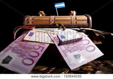 Honduran Flag On Top Of Crate Full Of Money