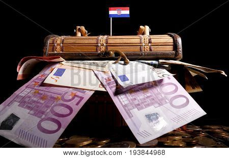 Croatian Flag On Top Of Crate Full Of Money