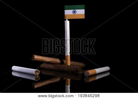 Indian Flag With Cigarettes And Cigars. Tobacco Industry Concept.