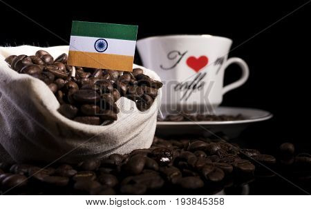 Indian Flag In A Bag With Coffee Beans Isolated On Black Background