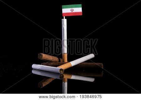 Iranian Flag With Cigarettes And Cigars. Tobacco Industry Concept.