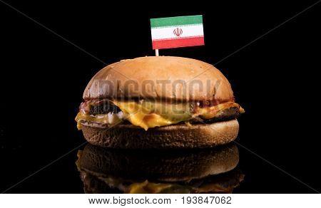 Iranian Flag On Top Of Hamburger Isolated On Black Background