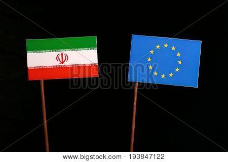 Iranian Flag With European Union (eu) Flag Isolated On Black Background
