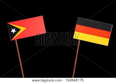 East Timorese Flag With German Flag Isolated On Black Background