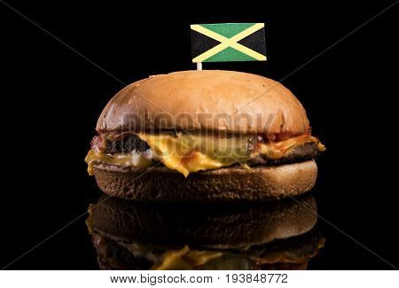 Jamaican Flag On Top Of Hamburger Isolated On Black Background