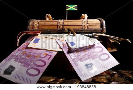 Jamaican Flag On Top Of Crate Full Of Money