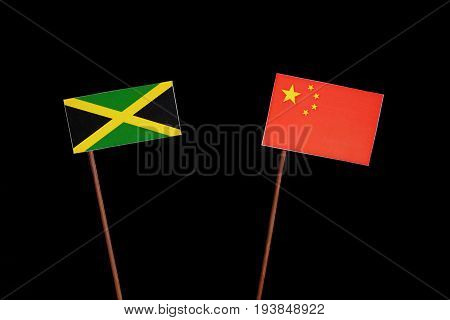 Jamaican Flag With Chinese Flag Isolated On Black Background