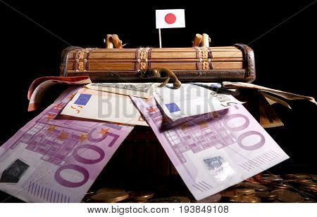 Japanese Flag On Top Of Crate Full Of Money