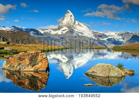 Amazing panorama with Matterhorn at morning and beautiful alpine lake Stellisee Valais region Switzerland Europe