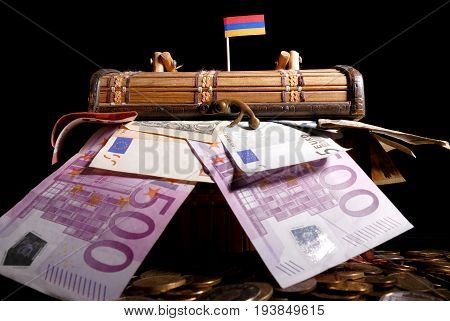 Armenian Flag On Top Of Crate Full Of Money