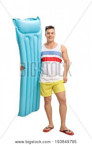 Full length portrait of a tourist holding an air mattress isolated on white background