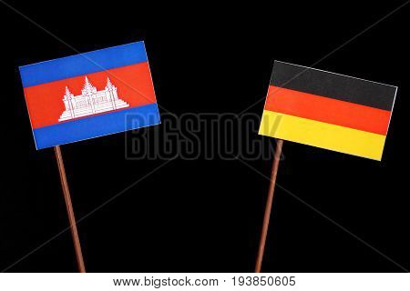 Cambodian Flag With German Flag Isolated On Black Background