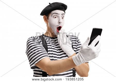 Surprised mime looking at a phone isolated on white background