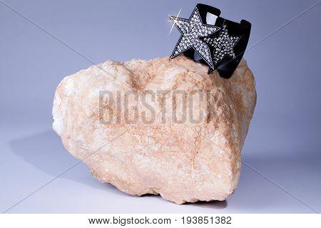 Glam Rock. Glitter jewelled bracelet bling diamond jewellery on rock. 70's glamrock music representation